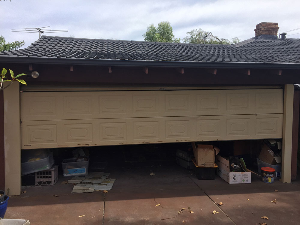 call a professional for a garage door springs replacement